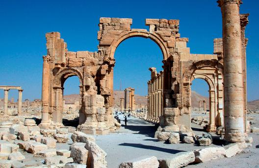 A file picture taken on June 19, 2010 shows the Arch of Triumph among the Roman ruins of Palmyra, 220 kms northeast of the Syrian capital Damascus. The Islamic State jihadist group executed three people in Syria's ancient city of Palmyra by binding them to three historic columns and blowing them up, a monitoring group said on October 26, 2015