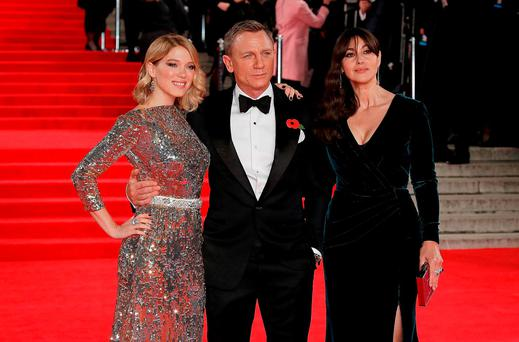 LONDON, ENGLAND - OCTOBER 26: Lea Seydoux, Daniel Craig and Monica Bellucci attend the Royal Film Performance of