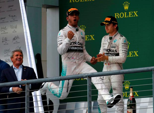 ... explains hat throwing incident with Nico Rosberg. Mercedes Formula One  driver Lewis Hamilton of Britain celebrates after winning the U.S. F1 Grand  Prix eb3ae94767dc