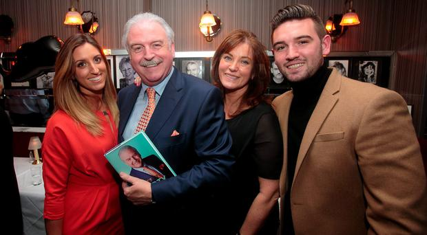 Marty Whelan with wife Maria, and children Jessica and Thomas during the launch of memoir 'That's Life' at Trocadero restaurant, Dublin. Photo: Gareth Chaney Collins