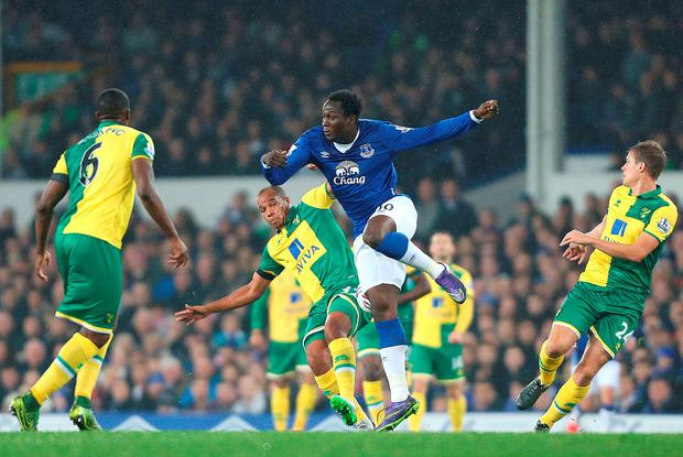 Everton's Romelu Lukaku and Norwich City's Vadis Odjidja-Ofoe battle for the ball during the Capital One Cup fourth round match at Goodison Park