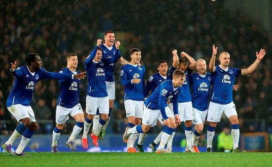 Everton players celebrate winning the penalty shoot-out