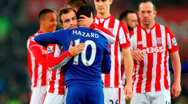 Stoke City's Xherdan Shaqiri (left) embraces Chelsea's Eden Hazard following the Capital One Cup, Fourth Round match at The Britannia Stadium