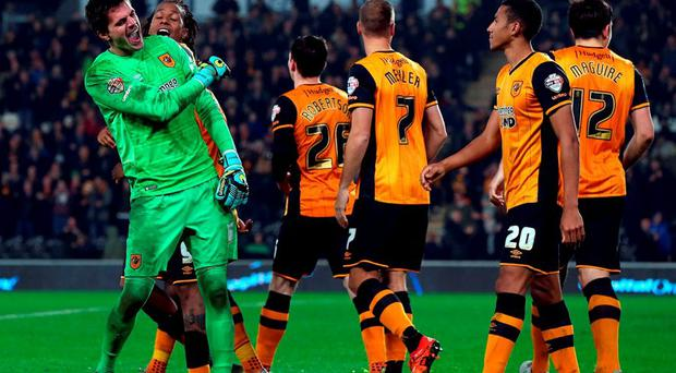 Eldin Jakupovic (L) of Hull City celebrates with teamates after a penalty shoot out win during the Capital One Cup