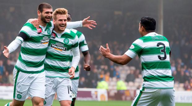 Celtic's Nadir Ciftci celebrates scoring his team's first goal of the game with Emilio Izaguirre (right). The pair were involved in a training ground row