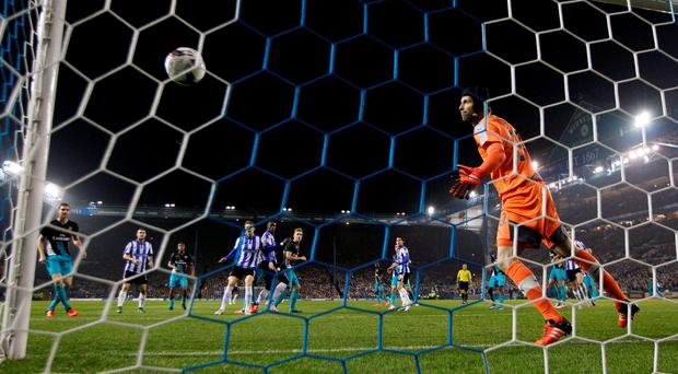 Peter Cech is powerless to prevent Sheffield Wednesday's Lucas Joao from scoring his team's second goalhalf