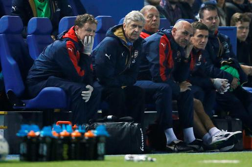 Arsene Wenger looks on at his Arsenal side
