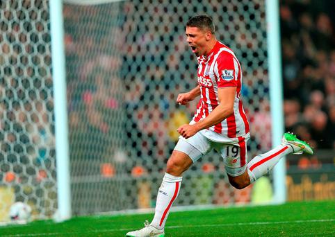 Jon Walters celebrates his goal as Stoke turned up the heat on Chelsea boss Jose Mourinho