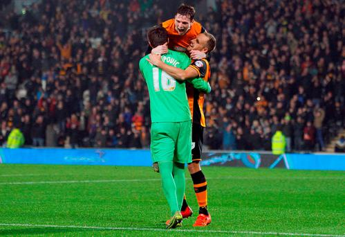 Hull celebrate David Meyler's winning penalty against Leicester
