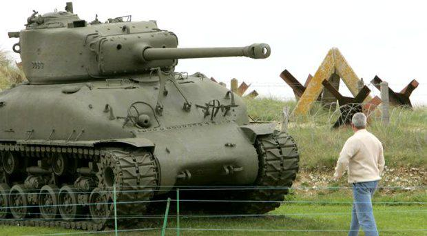 A World War II-era tank exploded at a public gun range in Oregon Tuesday killing two people. In this photo, dated May 14, 2004, a visitor strolls past the remains of a tank and tank traps on Utah Beach in Normandy ahead of ahead of the 60th anniversary of the World War II allied landings. Reuters/Mal Langsdon