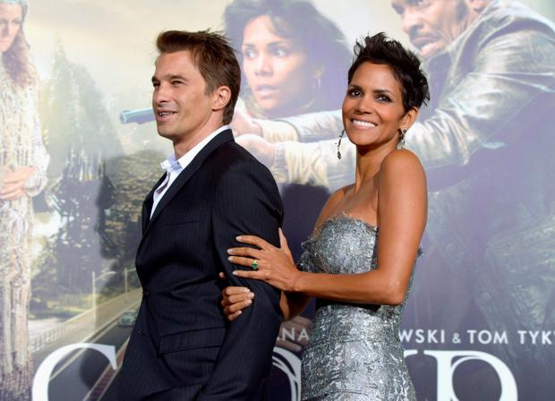 Actors Olivier Martinez and Halle Berry arrive at Warner Bros. Pictures'
