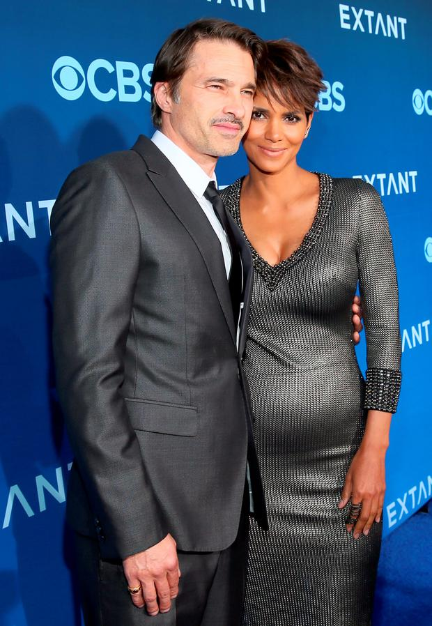 Actors Olivier Martinez (L) and Halle Berry attend Premiere Of CBS Television Studios & Amblin Television's