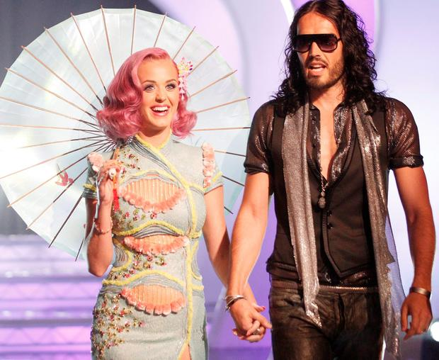 Singer Katy Perry and actor Russell Brand arrive at the 2011 MTV Video Music Awards at Nokia Theatre L.A. LIVE on August 28, 2011 in Los Angeles, California. (Photo by Christopher Polk/Getty Images)