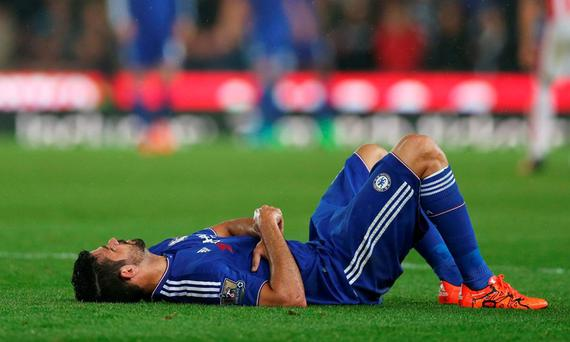 Chelsea's Diego Costa lies injured before being substituted Action Images via Reuters / Alex Morton