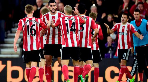 Southampton's Graziano Pelle (second right) celebrates with team-mates after scoring his side's second goal of the game during the Capital One Cup, Fourth Round match at St Mary's,