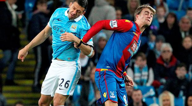 Crystal Palace's English striker Patrick Bamford (R) vies with Manchester City's Argentinian defender Martin Demichelis
