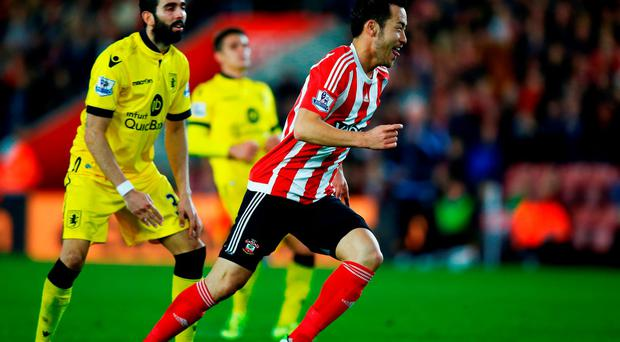 Maya Yoshida of Southampton celebrates scoring the opening goal