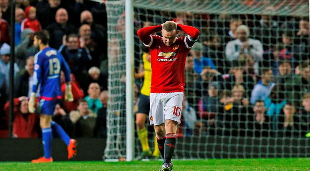 Manchester United's Wayne Rooney looks dejected after missing penalty