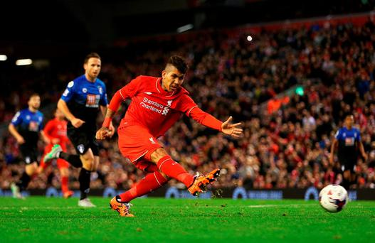 Roberto Firmino of Liverpool shoots