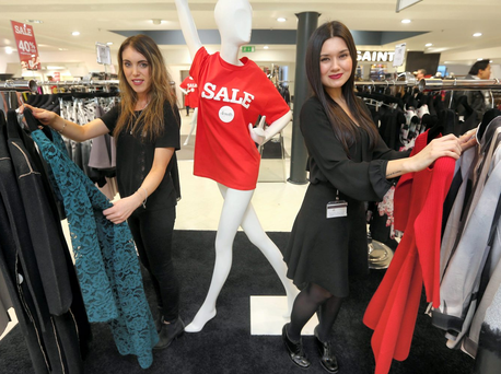 Arnotts staff Cintia Tanno (right) and Sara Hollingsworth prepare for the sales last Christmas Photo: Damien Eagers