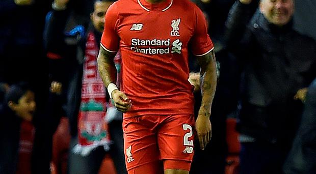 Liverpool's English defender Nathaniel Clyne scoring his team's first goal