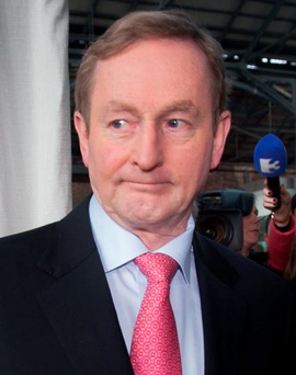 Enda Kenny is seeking to defuse tensions within the coalition