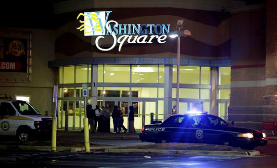Police stand outside of the entrance at the Washington Square Mall on Wednesday (AP Photo/Darron Cummings)