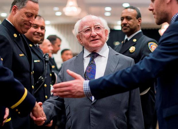 Ireland's President Michael Higgins meets first responders who answered the emergency call for the June 16, 2015 balcony collapse that killed 6 students in Berkeley, California REUTERS/Noah Berger