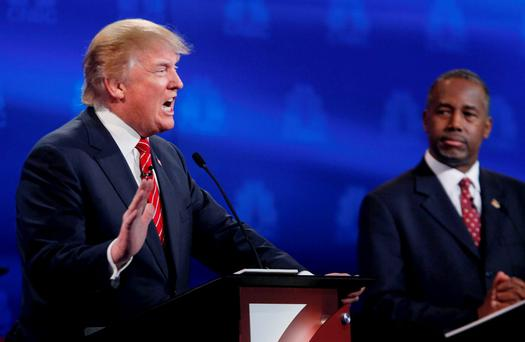 Republican U.S. presidential candidate businessman Donald Trump speaks as Dr. Ben Carson (R) looks on at the 2016 U.S. Republican presidential candidates debate held by CNBC in Boulder, Colorado REUTERS/Rick Wilking
