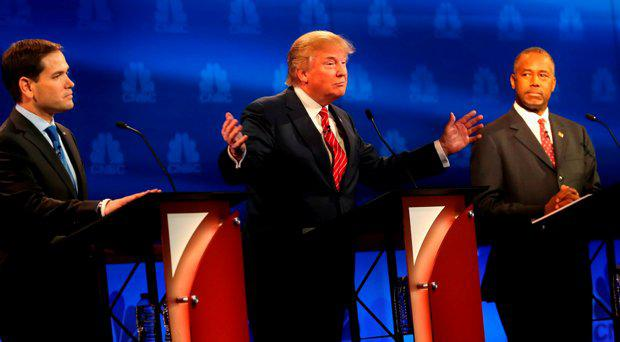 Presidential candidates Donald Trump (L) speaks while Ben Carson (R) and Sen. Marco Rubio (R-FL) look on during the CNBC Republican Presidential Debate at University of Colorados Coors Events Center October 28, 2015 in Boulder