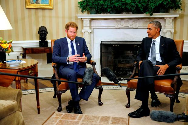 U.S. President Barack Obama talks to Britain's Prince Harry (L) during a meeting at the Oval Office at the White House in Washington October 28, 2015. REUTERS/Carlos Barria