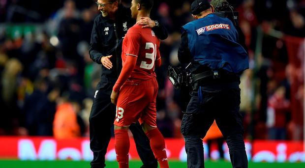 Jurgen Klopp with Liverpool's English midfielder Jordon Ibe following the English League Cup fourth round football match between Liverpool and Bournemouth