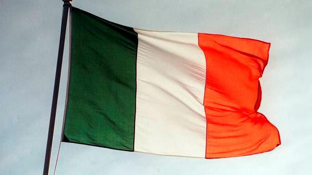 The raising of Irish flags at a new social housing estate in an attempt to