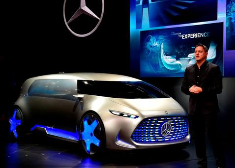 Mercedes Benz head of design Gordon Wagner displays the new