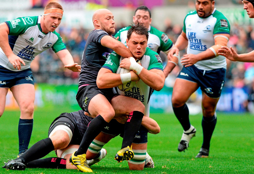 Connacht's Quinn Roux is tackled by Richard Fussell of Ospreys during the Westerners' impressive victory