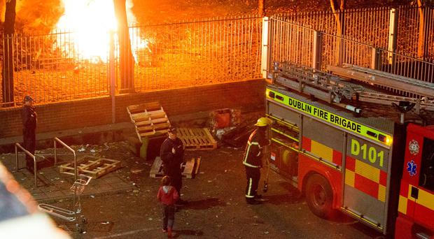 Dublin Fire Brigade attend at the Bonfire at Basin St Flats last night. Photo: Colin O'Riordan
