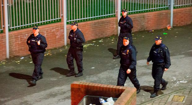 Public Order Unit Gardai arrive at the Bonfire at Basin St Flats last night. Photo: Colin O'Riordan