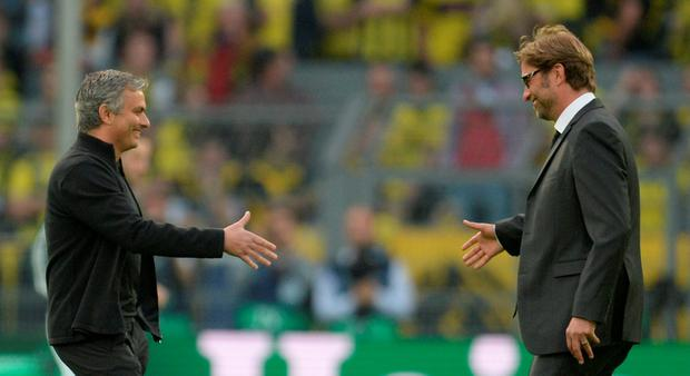 Jose Mourinho and Jurgen Klopp shake hands before a match between Real Madrid and Borussia Dortmund in 2013. Dortmund won 4-1