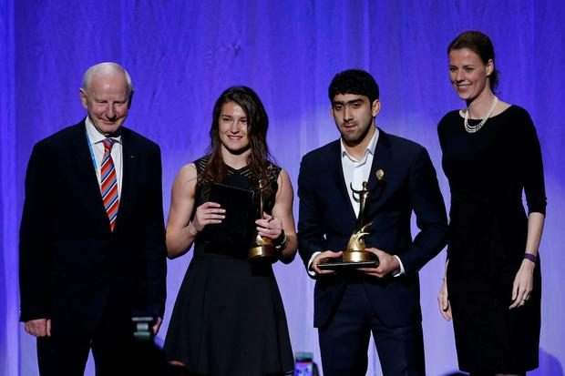 (L-R) Pat Hickey, Katie Taylor, Togrul Asgarov of Azerbaijan and Claudia Bokel of Germany pose on stage during the 2015 ANOC Awards at DAR Constitution Hall. Mandatory Credit: Geoff Burke-USA TODAY Sports