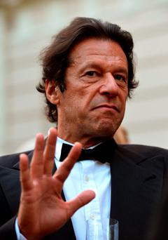 File photo dated 09/07/13 of former cricketer and head of Pakistan's opposition Tehreek-e-Insaf party Imran Khan, who is to divorce his wife less than a year after the pair wed. Anthony Devlin/PA Wire