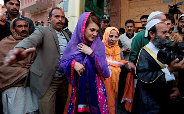 FILE - In this Friday, Jan. 9, 2015 file photo, Reham Khan, center, wife of Pakistan's cricketer-turned-politician Imran Khan, leaves a local madrassa, or seminary, in Islamabad, Pakistan. (AP Photo/B.K. Bangash,file)