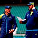 Michael Cheika talks with Mario Ledesma during the Captain's Run ahead of the 2015 Rugby World Cup Final against New Zealand at Twickenham Stadium