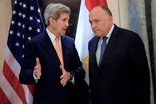 US Secretary of State John Kerry, left, and Egyptian Foreign Minister Sameh Shoukry share a word prior to talks on Syria at a hotel in Vienna, Austria (Brendan Smialowski/Pool Photo via AP)