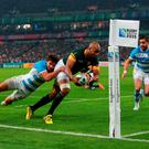 South Africa's JP Pietersen scores his sides first try during the bronze medal match at the Olympic Stadium, London