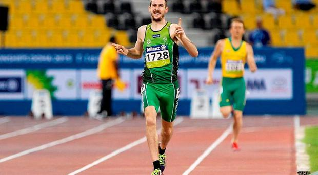 Ireland's Michael McKillop begins his celebrations as he approaches the line in yesterday's 1500m T37 final in Doha