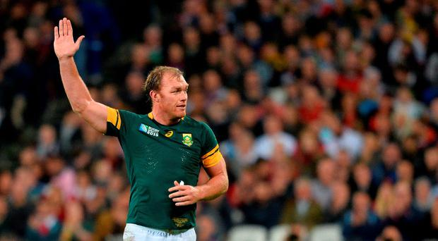 South Africa's flanker Schalk Burger waves as he leaves the pitch during the bronze medal match of the 2015 Rugby World Cup between South Africa and Argentina AFP PHOTO / GLYN KIRK