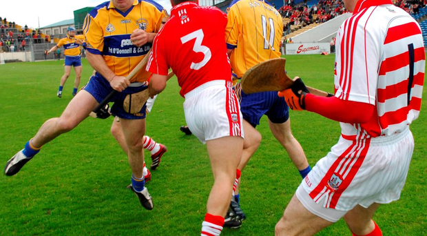 Donal Og Cusack has a bird's eye view as Cork team-mate Diarmuid O'Sullivan is the meat in the sandwich between Clare's Colin Lynch (left) and Diarmuid McMahon during an infamous Munster SHC clash in 2007