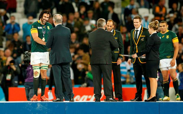 Rugby Union - South Africa v Argentina - IRB Rugby World Cup 2015 Third/Fourth Place Bronze Final Play-Off - Olympic Stadium, London, England - 30/10/15 South Africa's Victor Matfield (L) as he is awarded his bronze medal during a ceremony after the match Action Images via Reuters / Andrew Boyers Livepic