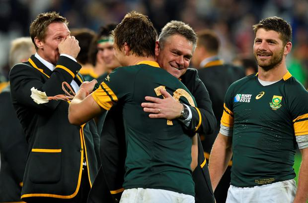 Rugby Union - South Africa v Argentina - IRB Rugby World Cup 2015 Third/Fourth Place Bronze Final Play-Off - Olympic Stadium, London, England - 30/10/15 South Africa head coach Heyneke Meyer celebrates victory with Handre Pollard Reuters / Toby Melville Livepic