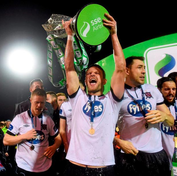 Dundalk's Dane Massey celebrates with the trophy after the game